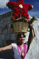Chines de Oaxaca, woman holding flower basket on head, 1982