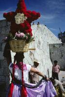Chines de Oaxaca, woman holding flower basket on head, 1982