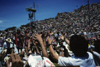 Tlaxiaco, performers throwing gifts to spectators, 1985