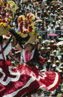 Chines de Oaxaca, woman dancing with flower basket on head [blurred], 1982
