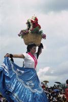 Chines de Oaxaca, woman dancing with flower basket on head [blurred], 1982