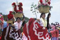 Chines de Oaxaca, women dancing with flower basket on heads [blurred], 1982