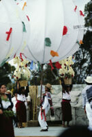 Tlacolula del Valle, performers with large ballons and baskets of flowers, 1985