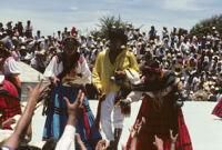 Ejutla de Crespo, performers handing gifts to spectators, 1982