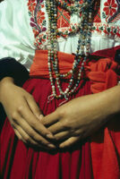 Ejutla de Crespo, close-up of woman's hands and beads at waist, 1982