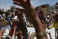 Ejutla de Crespo, performers throwing gifts to spectators, 1982