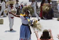 Tlaxiaco, performers throwing gifts to spectators, 1982 or 1985