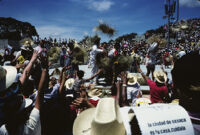 Tlaxiaco, performers throwing straw hats to spectators, 1982 or 1985