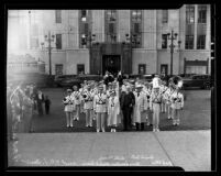 Harry Chandler with Texas Christian University Band in front of Los Angeles Times building, 1935
