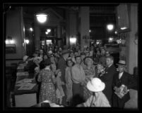"""Crowd in Los Angeles Times office for deadline in Times """"Bible Game"""" contest, 1934"""