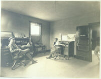 Two men seated in office at Universal City, Calif., circa 1915