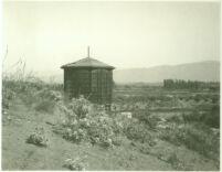 Watertower with landscape around Universal City, Calif., 1915