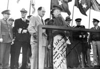 Edwin Pauley, Dwight D. Eisenhower and military officials on platform, with handwritten inscription by Eisenhower