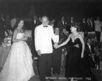 Edwin Pauley and his wife, Barbara Jean with Ethel Merman at the Pauley's 15th wedding anniversary party, 1952