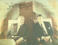 Edwin Pauley and Ronald Reagan on airplane, with handwritten inscription by Reagan
