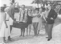 Edwin Pauley, Ed Carter, Harriet & Charles Luckman, and Troy Post at beach party