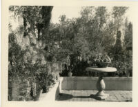 Wright Saltus Ludington residence, view of wisteria lined terrace with round pedestal table, Montecito, 1931