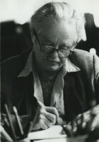Kenneth Rexroth at desk writing, circa 1980