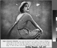 Oversized reprints of models wearing Cashin's fashion designs.