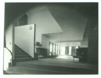 Lovell House, interior room with fireplace at bottom of stairs