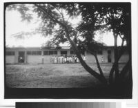 Home for Girls, children outside classroom building