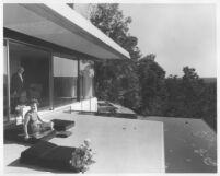 Rice House, Richard J. Neutra & woman on terrace