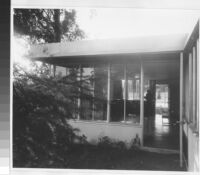 Richter House, exterior view looking into livingroom