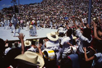 Macuiltianguis, performers throwing gifts to spectators, 1985
