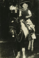 Carey McWilliams riding a pony at age 5