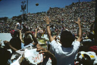 Flor de Pina, performers throwing gifts to spectators, 1982