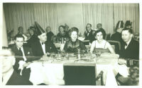 Ruth Eleanor McKee with others at dinner party on board ship S.S. America, 1963