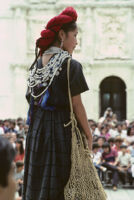 Awarding of prizes[?], woman holding netted bag, 1985