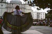 Awarding of prizes[?], woman displaying her skirt, 1985