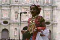 Awarding of prizes[?], woman singing, 1985