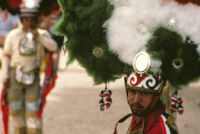 Saints Day, man wearing large headdress, 1982