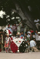 Saints Day, man wearing black mask and children in costume, 1982