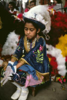 Saints Day, girl wearing white gloves, 1982