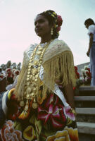 Awarding of prizes[?], woman wearing sash and gold necklace, 1985