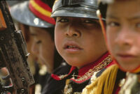 Saints Day, faces of boys wearing soldier costumes, 1982