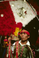 Saints Day, man holding large headdress, 1982