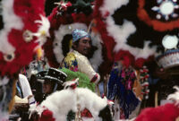 Saints Day, man surrounded by headdresses, 1982