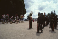 Saints Day, groups of band members and men in large headdresses, 1982