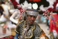 Saints Day, man wearing large headdress, 1982