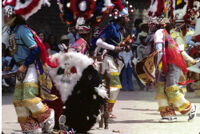 Saints Day, men wearing large headdresses, 1982