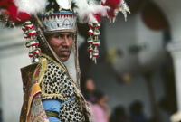 Saints Day, face of man wearing large headdress, 1982