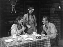 Girl of the Golden West [?] play production, Indian woman serving couple at table