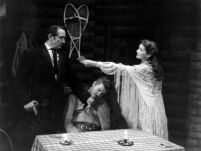 Girl of the Golden West [?] play production, Mary Robbins character [?] handing money to sherriff