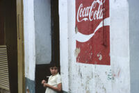 Oaxaca, boy and Coca-Cola sign, 1982 or 1985