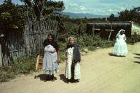 Oaxaca, women walking down rural road, 1982 or 1985