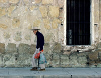 Oaxaca, old man walking down sidewalk, 1982 or 1985